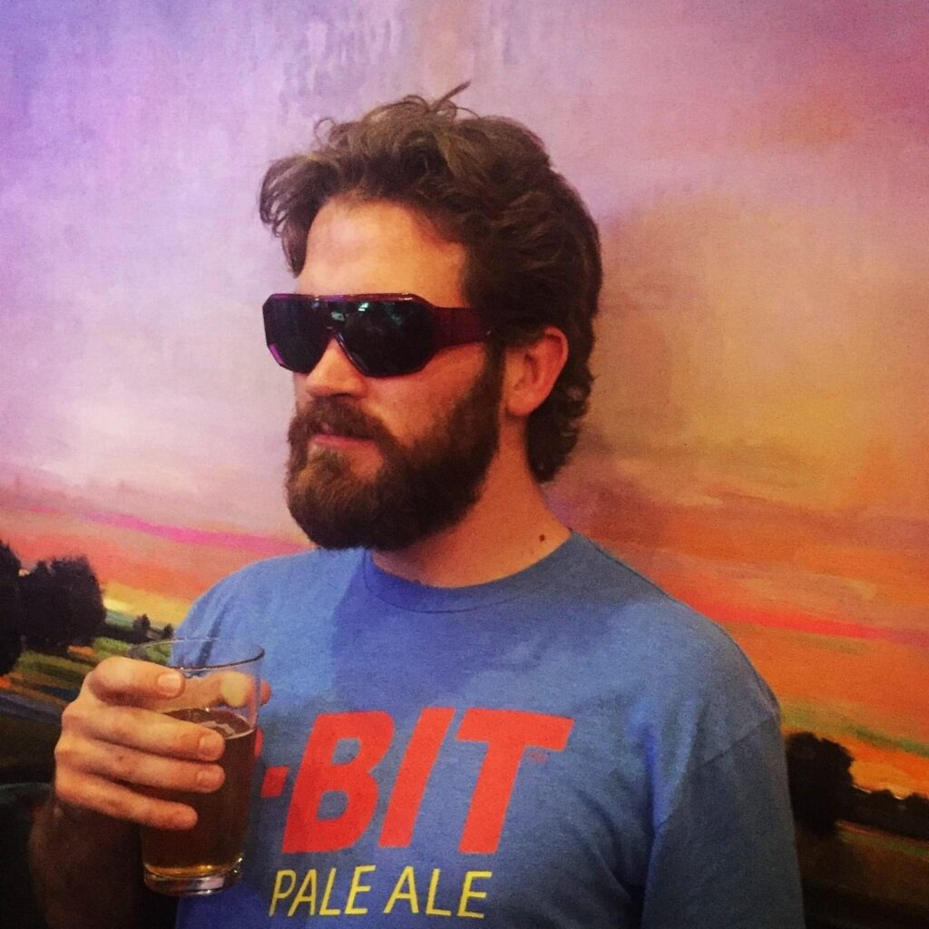 Brady with a beer and sunglasses