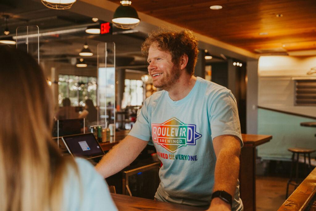 Boulevard bartender in Pride shirt